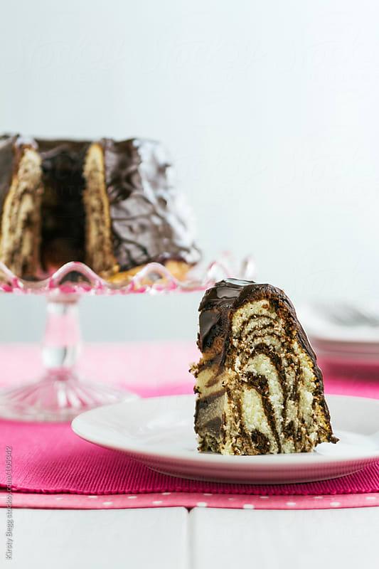 Zebra print chocolate bundt cake vertical by Kirsty Begg for Stocksy United