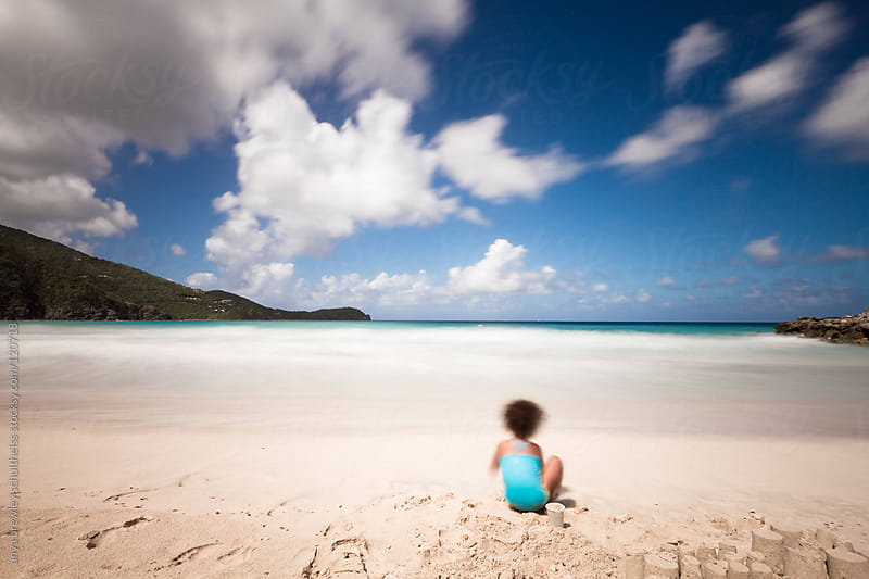 Girl on beach with white sand and blue skies by anya brewley schultheiss for Stocksy United