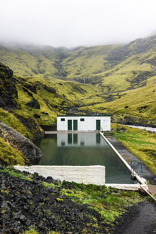 The abandoned geothermal pool of Seljavellir in Iceland by Jonatan Hedberg for Stocksy United