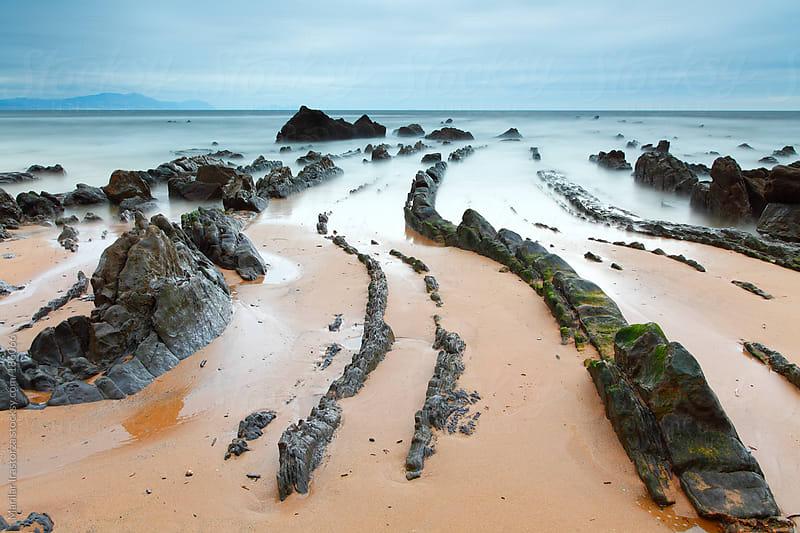 Beach with Rocks by Marilar Irastorza for Stocksy United