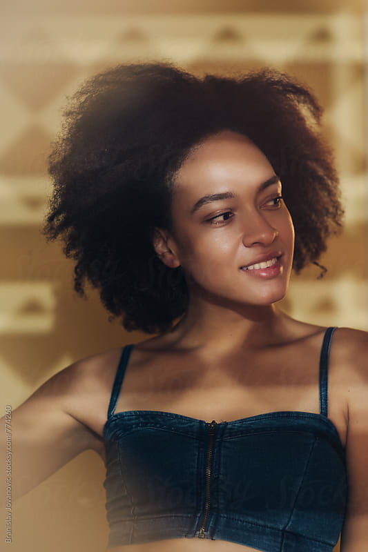 Portrait of a Beautiful Smiling Woman with Afro Hairstyle by Brkati Krokodil for Stocksy United