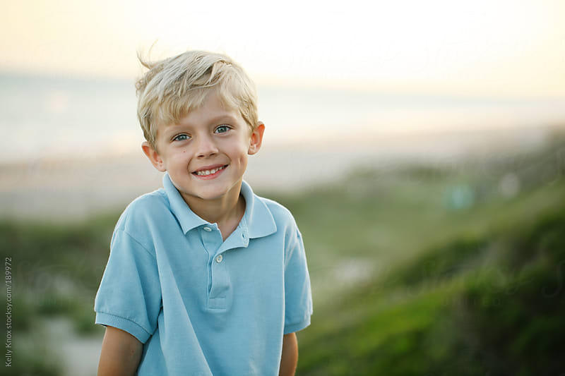 portrait of a happy boy at the beach by Kelly Knox for Stocksy United