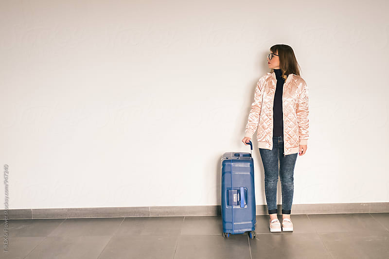 Stylish woman with blue baggage by Danil Nevsky for Stocksy United