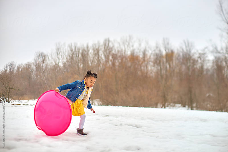Young Girl Playing in the Snow by suzanne clements for Stocksy United