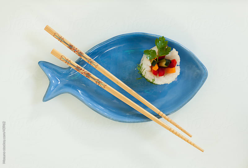 Sushi served on a fish shaped plate. by Mosuno for Stocksy United