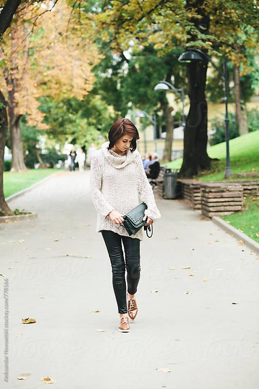 Beautiful woman taking a walk in the park by Aleksandar Novoselski for Stocksy United