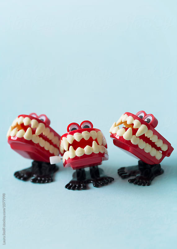 The singers: close up of wind up vampire chattering teeth toys  by Laura Stolfi for Stocksy United