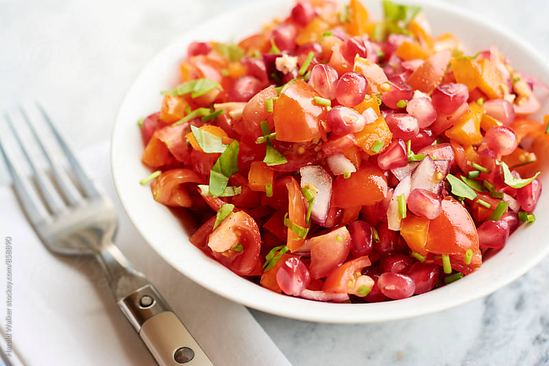 Tomato Pomegranate Salad by Harald Walker for Stocksy United