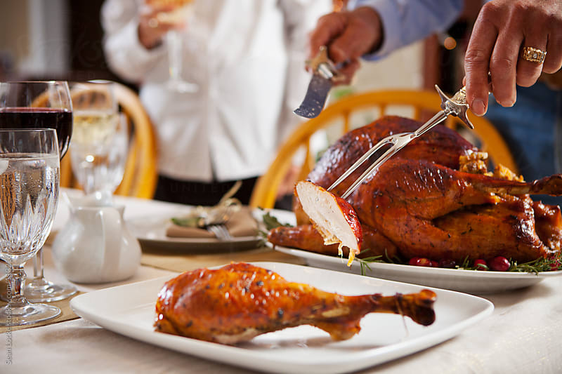 Thanksgiving: Carving Delicious White Meat From Bird by Sean Locke for Stocksy United