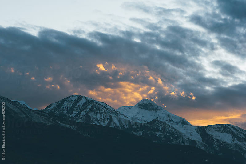 Fiery clouds as sun sets in the himalayas. by Shikhar Bhattarai for Stocksy United