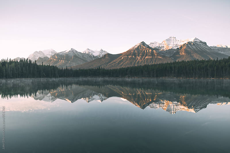 Morning Sunrise Reflections in Banff  by Jake Elko for Stocksy United