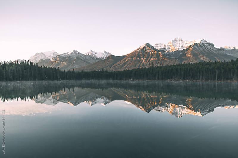 Morning Sunrise Reflections in Banff  by Jake Elko for Stocksy United