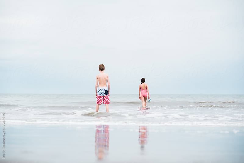 kids in the ocean by Léa Jones for Stocksy United
