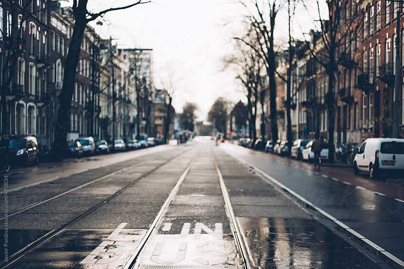 Tram rails through the streets of Amsterdam. by Javier Pardina for Stocksy United