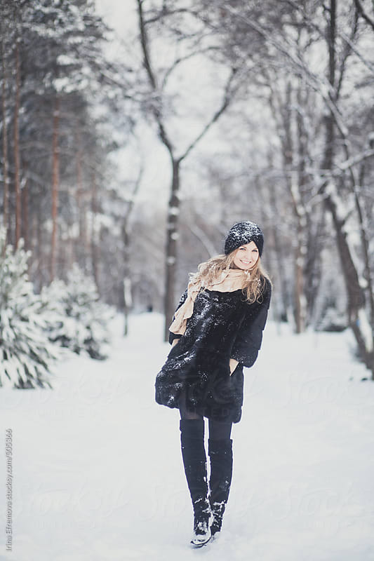 Attractive blond girl in a winter park by Irina Efremova for Stocksy United