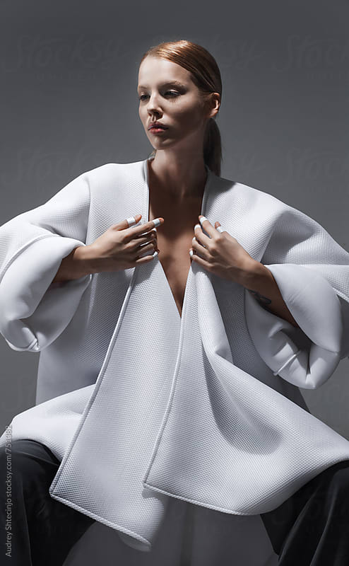 Beautiful sensual female in modern white kimono/fine art/fashion portrait by Marko Milanovic for Stocksy United