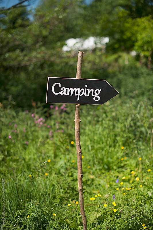 Camping sign by Jose Coello for Stocksy United