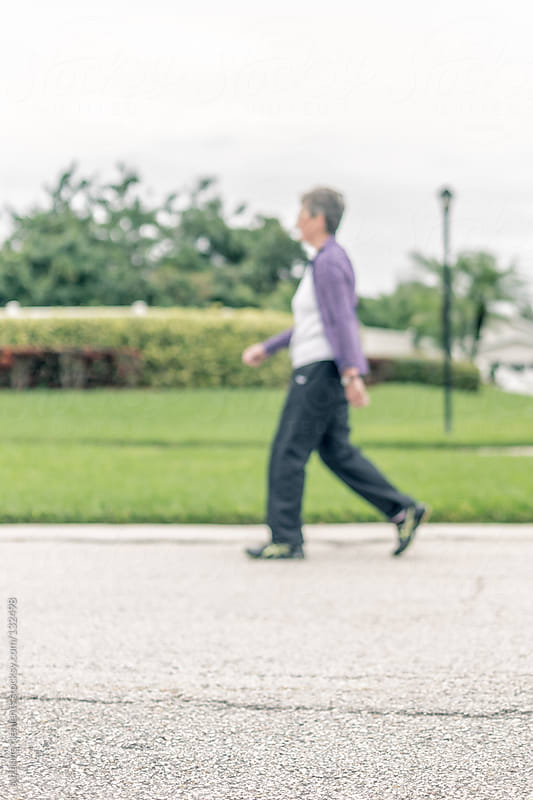 Active Retiree Participates in a 3k Walk  by suzanne clements for Stocksy United