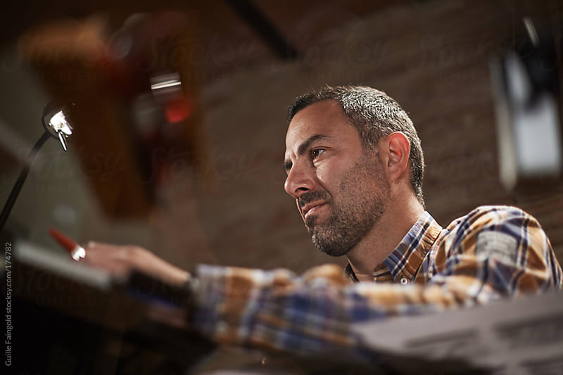 handsome business man working with his laptop - angle shot. by Guille Faingold for Stocksy United