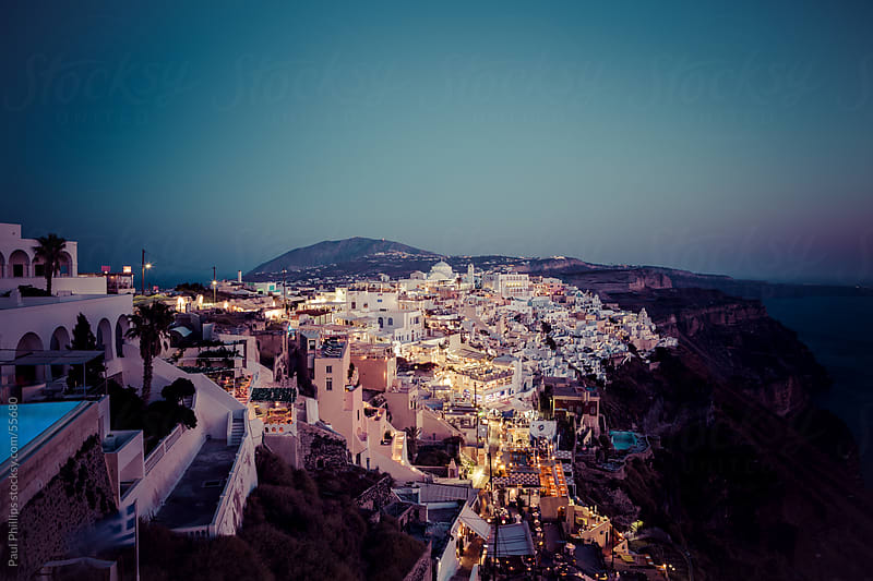 Fira the capital of the Greek island Santorini at night by Paul Phillips for Stocksy United