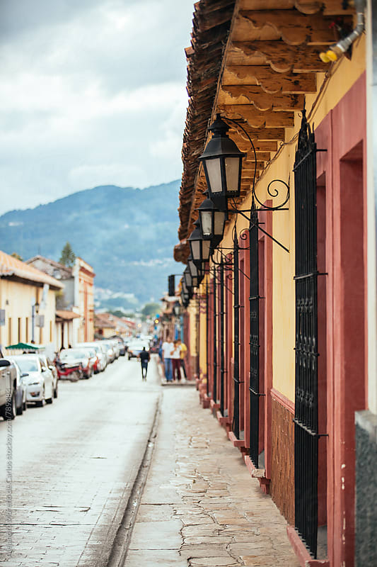 Typical picturesque colonial street with lamps in the exterior of houses in Chiapas, Mexico by Alejandro Moreno de Carlos for Stocksy United
