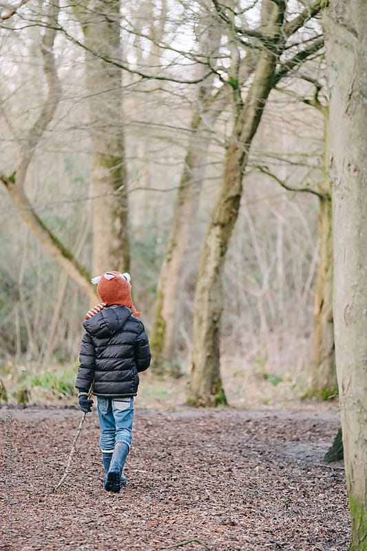 Child in the woods by Rebecca Spencer for Stocksy United