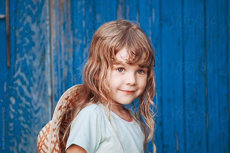 Little girl in a hat by Sveta SH for Stocksy United