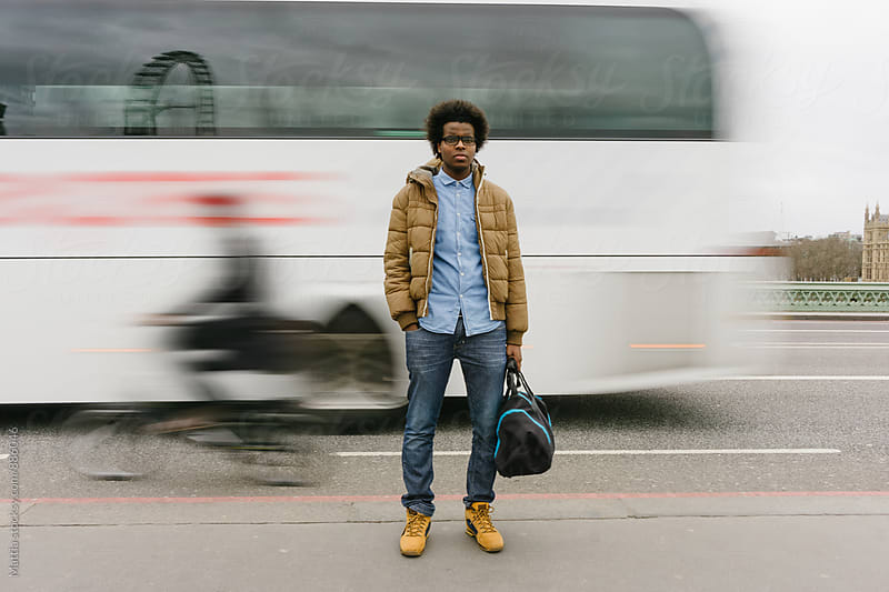 Young Black Man in the London Traffic . United Kindom by HEX. for Stocksy United