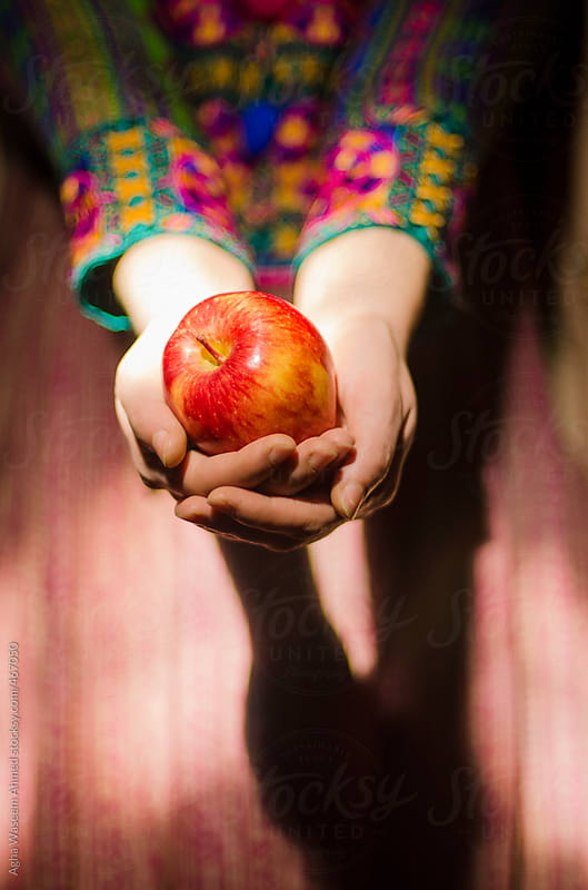 An apple a day keeps doctor away by Agha Waseem Ahmed for Stocksy United