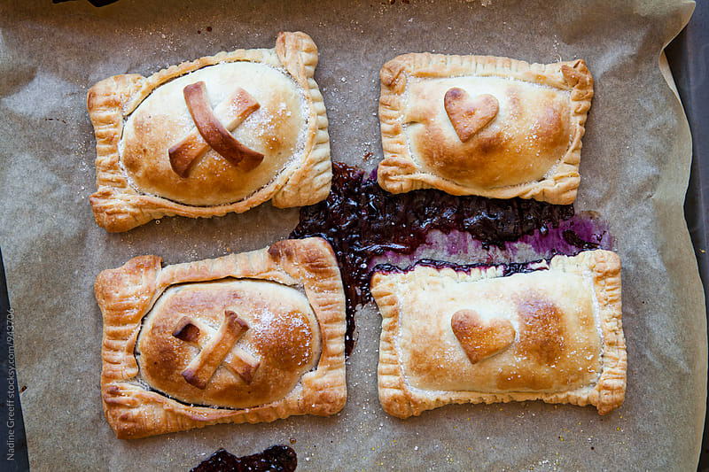 Mini blueberry pies by Nadine Greeff for Stocksy United