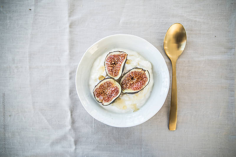 Yoghurt with figs and honey by Sophia van den Hoek for Stocksy United