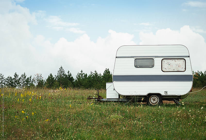 White RV parked on the mountain field by Aleksandra Jankovic for Stocksy United