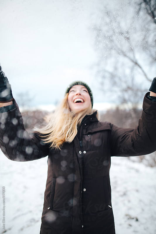 Blonde Woman Plays in Snow by Jake Elko for Stocksy United