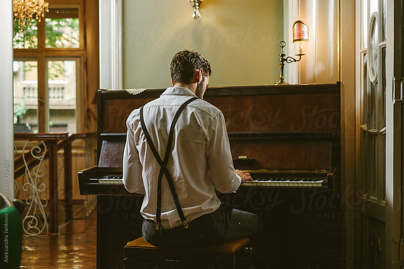 Back View of a Man Playing Piano by Aleksandra Jankovic for Stocksy United