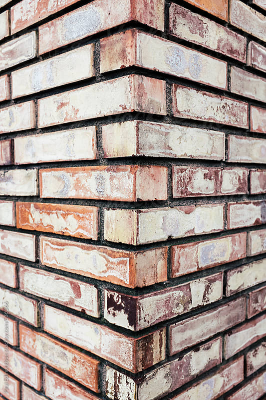 Corner of brick wall, close up by Paul Edmondson for Stocksy United