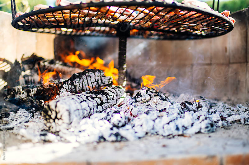 grilled meat on a Sunday by Javier Pardina for Stocksy United