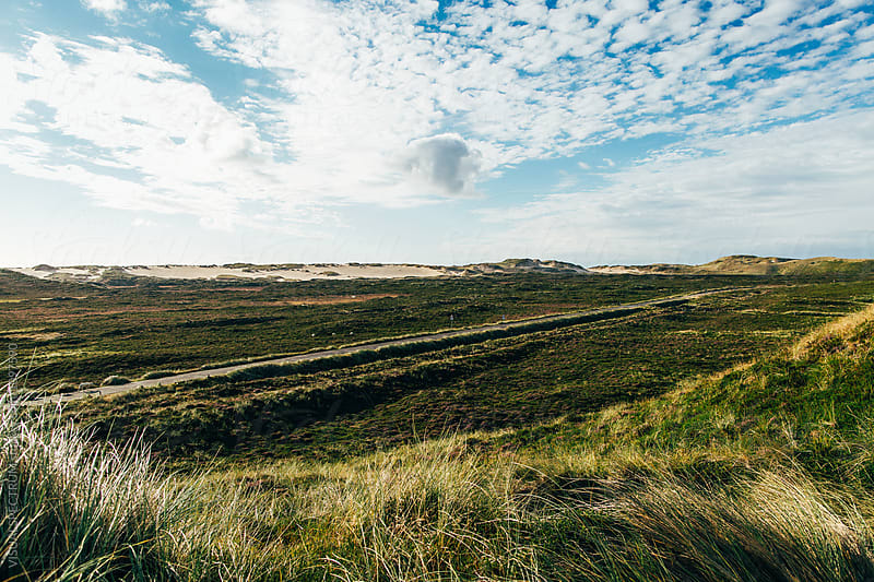Empty Road Through Dramatic Dune Landscape on Sylt (Germany) by Julien L. Balmer for Stocksy United
