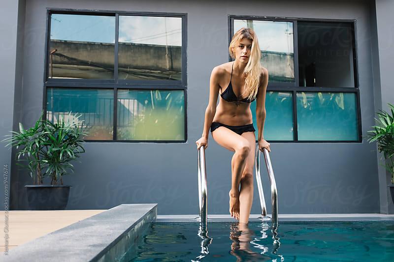 Sexy Blond Woman Enters the Pool by Nemanja Glumac for Stocksy United