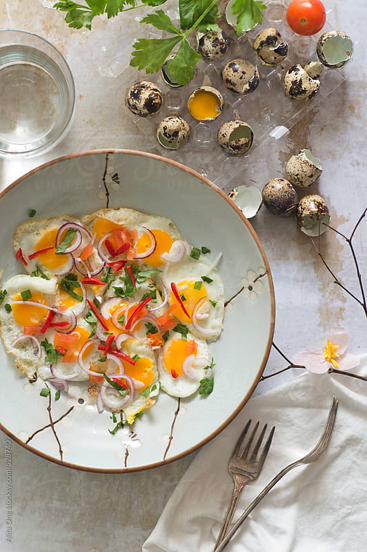 Fried quail eggs salad by Alita Ong for Stocksy United