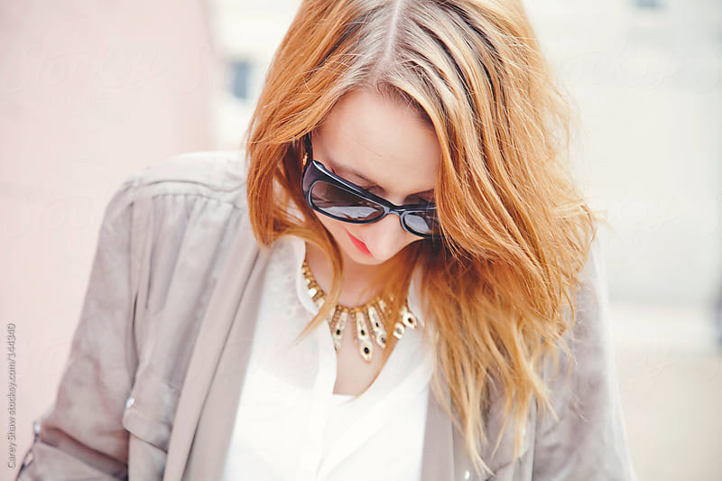 Stylish young woman wearing black sunglasses by Carey Shaw for Stocksy United