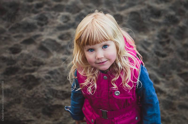 Little blue eyes on beach. by Cherish Bryck for Stocksy United