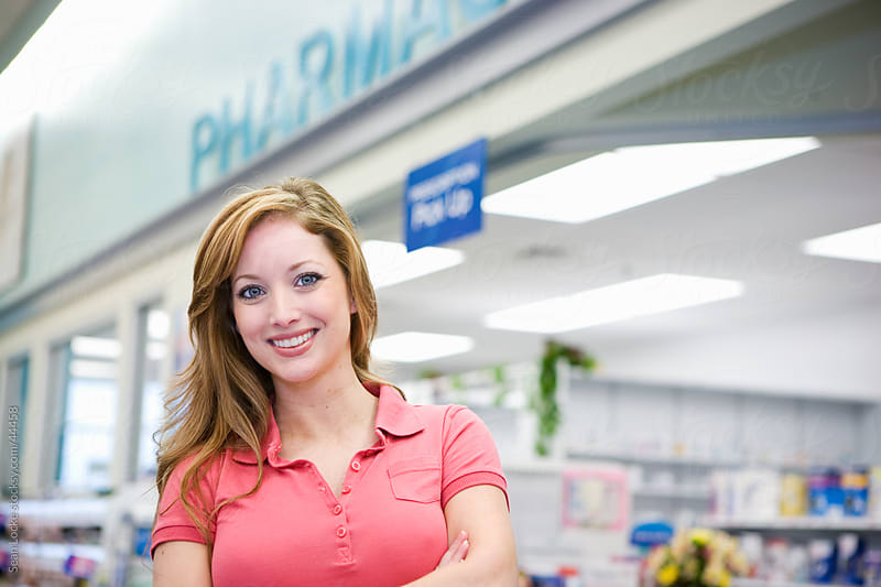 Grocery: Woman Stands By Pharmacy by Sean Locke for Stocksy United