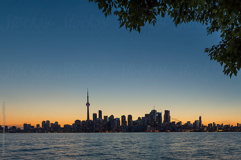 Toronto Skyline and Lake Ontario at Sunset, Canada by Tom Uhlenberg for Stocksy United