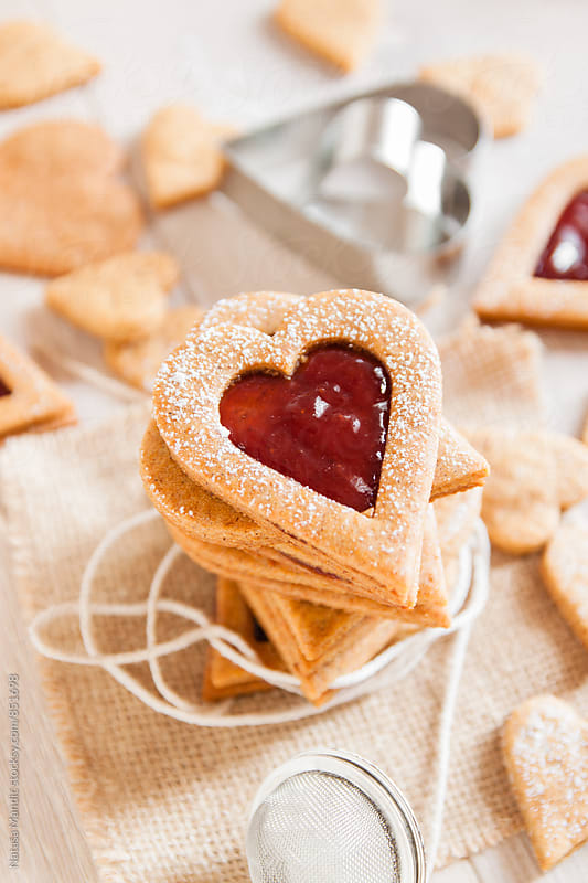 Heart shaped biscuits with strawberry jam by Nataša Mandić for Stocksy United