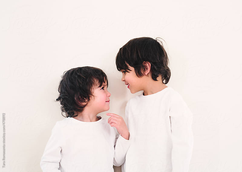 two little boys look at each other lovingly by Tara Romasanta for Stocksy United