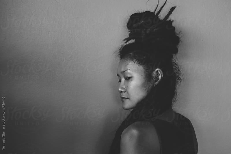 Authentic Thai Woman With Dreadlocks Looking Over Her Shoulder by Nemanja Glumac for Stocksy United