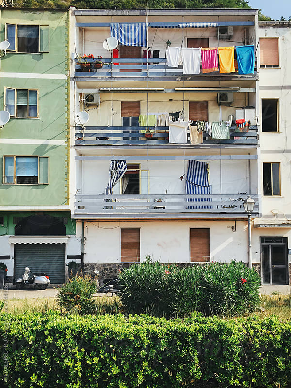 Italy - Apartment Block With Laundry Hanging on Balcony by Julien L. Balmer for Stocksy United