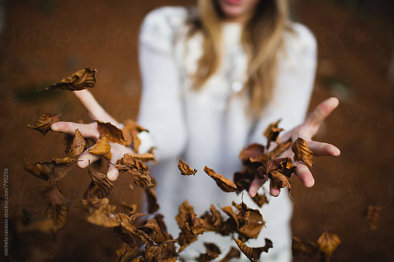 Female hands throwing leaves in air by michela ravasio for Stocksy United