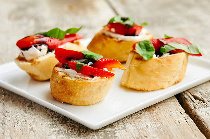 Crostini with Roasted Peppers by Harald Walker for Stocksy United