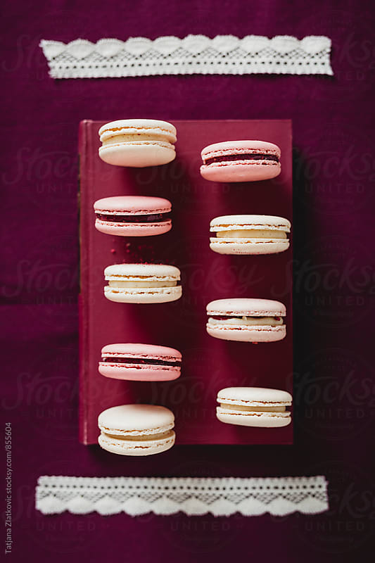 Macaroons on a book by Tatjana Ristanic for Stocksy United